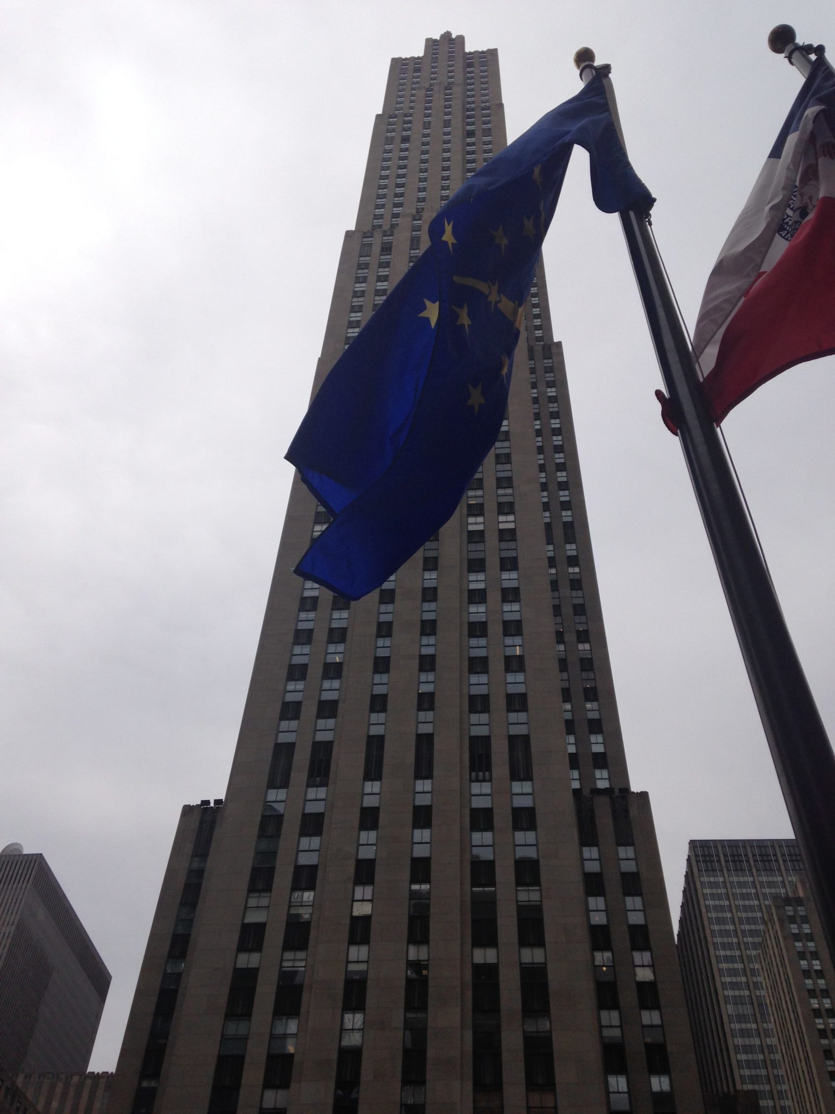 Flags flying in front of the Rockefeller Centre in New York.