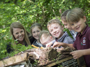 Children learning through creating outdoors